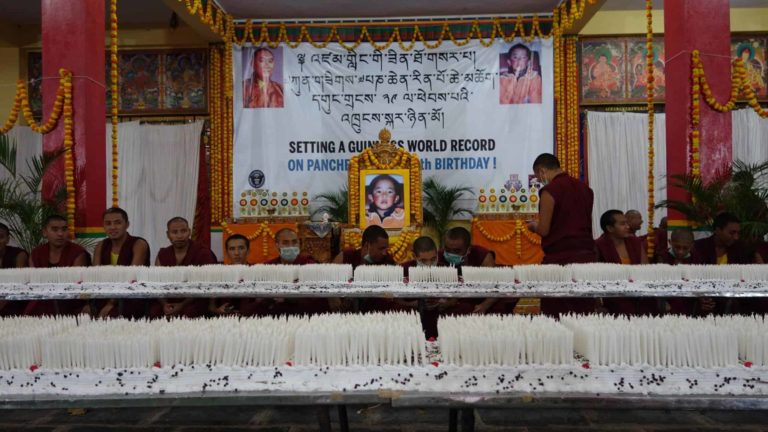 Setting a world record on Panchen Lama's birthday for the most number of candles lit on a cake.