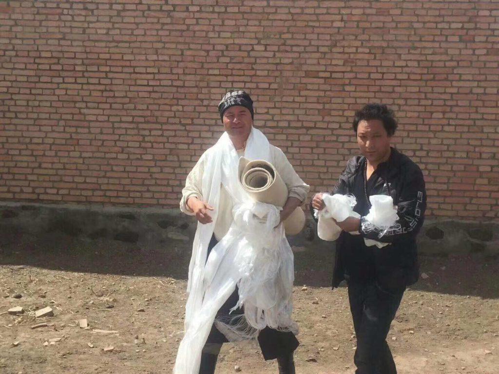 Shokjang greeted by Tibetan writer Theurang upon his release.